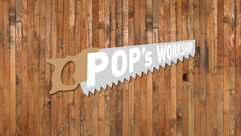pops workshop logo, shaped like a handsaw